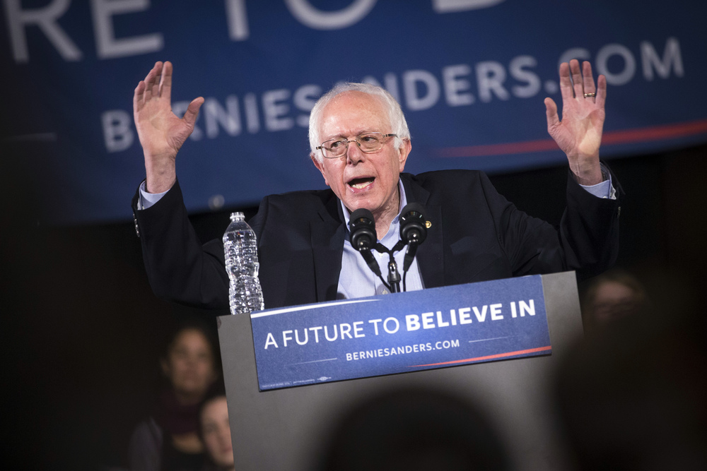 Democratic presidential candidate Sen. Bernie Sanders, I-Vt., speaks during a campaign stop at the Rochester Opera House, Thursday, Feb. 4, 2016, in Rochester, N.H. (AP Photo/John Minchillo)