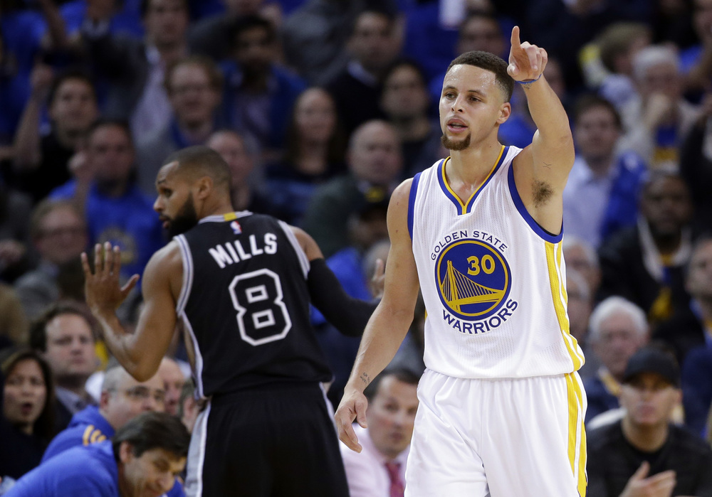 Golden State Warriors' Stephen Curry lobbies for possession in front of San Antonio Spurs' Patty Mills (8) during the first half of an NBA basketball game, Monday, Jan. 25, 2016, in Oakland, Calif. (AP Photo/Marcio Jose Sanchez)