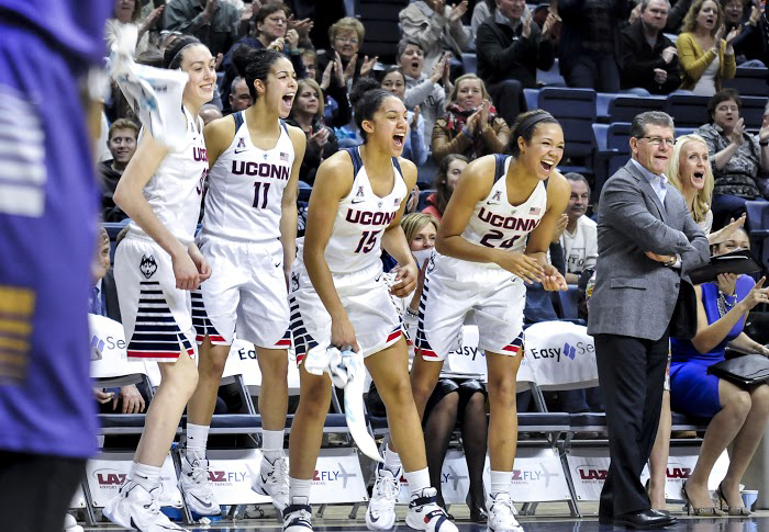 (Left to right) Breanna Stewart, Kia Nurse, Gabby Williams, Napheesa Collier and Geno Auriemma watch as the walk-ons get in on the action. (Bailey Wright/The Daily Campus)