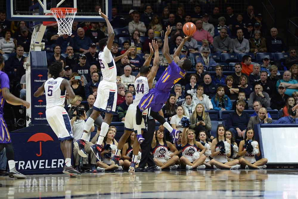 Left to right: Daniel Hamilton (5), Amida Brimah (35) and Rodney Purvis (44) force a tough shot from East Carolina's Prince Williams on during UConn's 85-67 victory at Gampel Pavilion. The Huskies swarming defense held ECU to 37.1 percent shooting. (Ashley Maher/The Daily Campus)