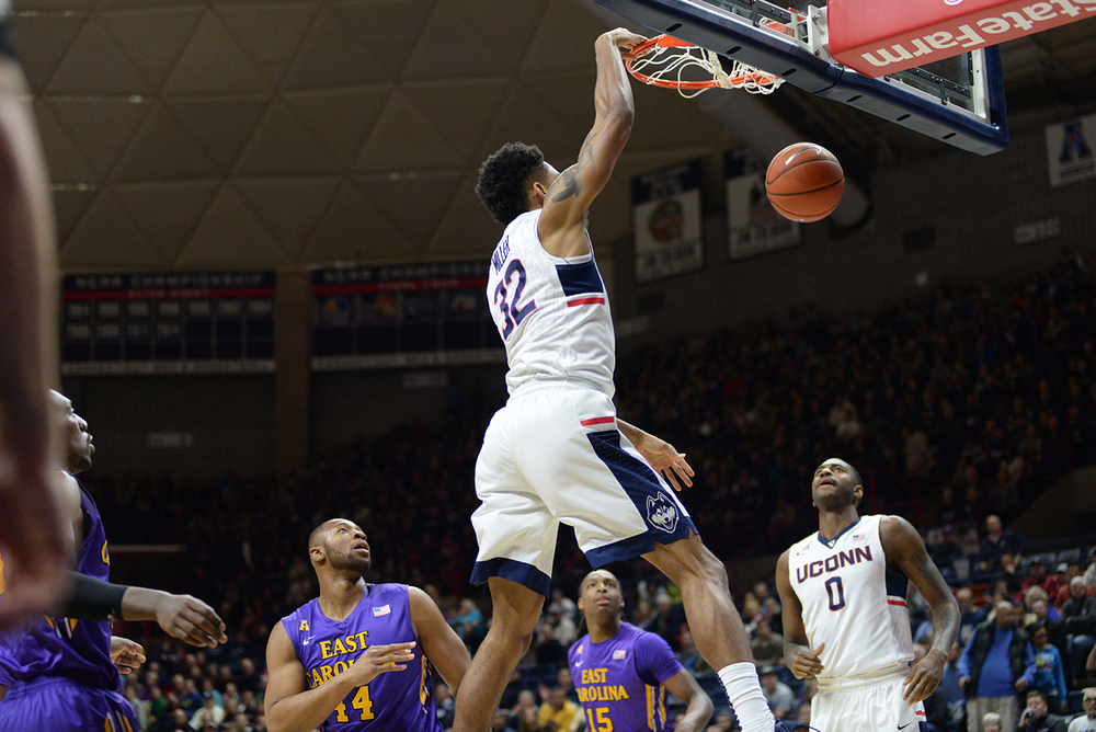 Graduate transfer Shonn Miller soars in for a dunk during UConn's 85-67 victory over ECU at Gampel Pavilion on Sunday. Miller finished with a team-high 16 points. (Ashley Maher/The Daily Campus).