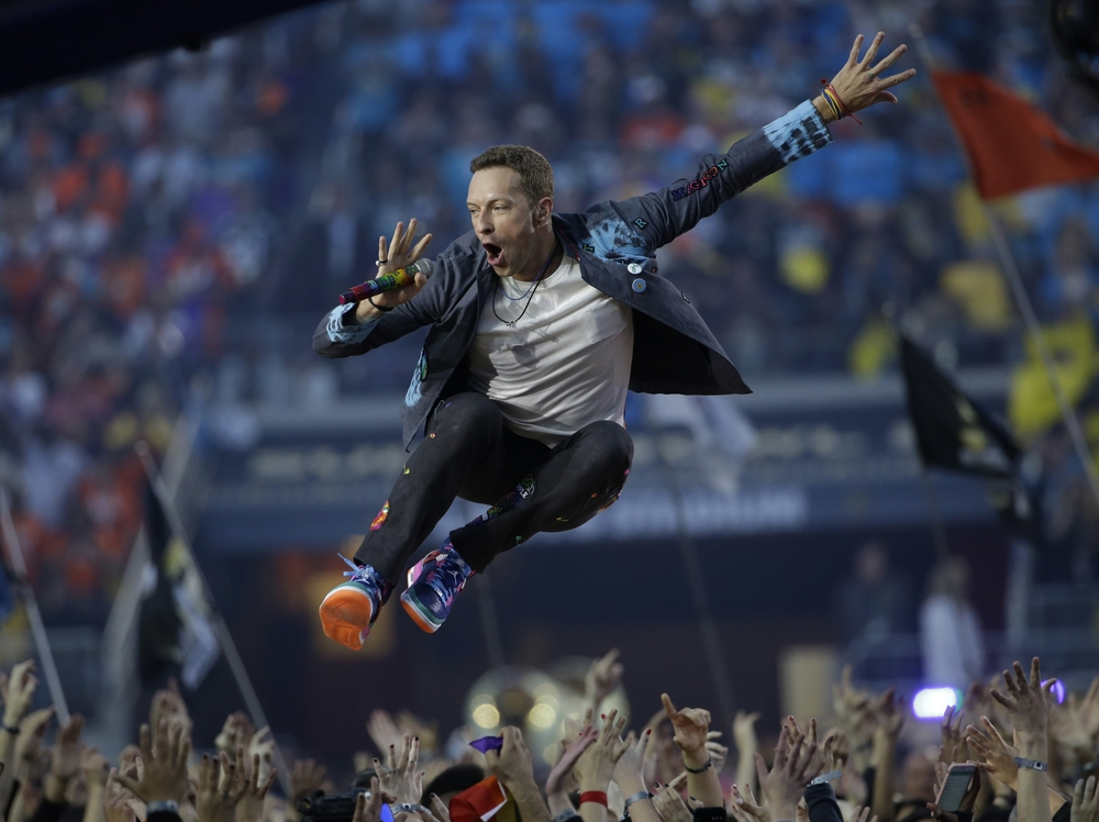 Coldplay singer Chris Martin performs during halftime of the NFL Super Bowl 50 football game Sunday, Feb. 7, 2016, in Santa Clara, Calif. (AP Photo/Marcio Jose Sanchez)