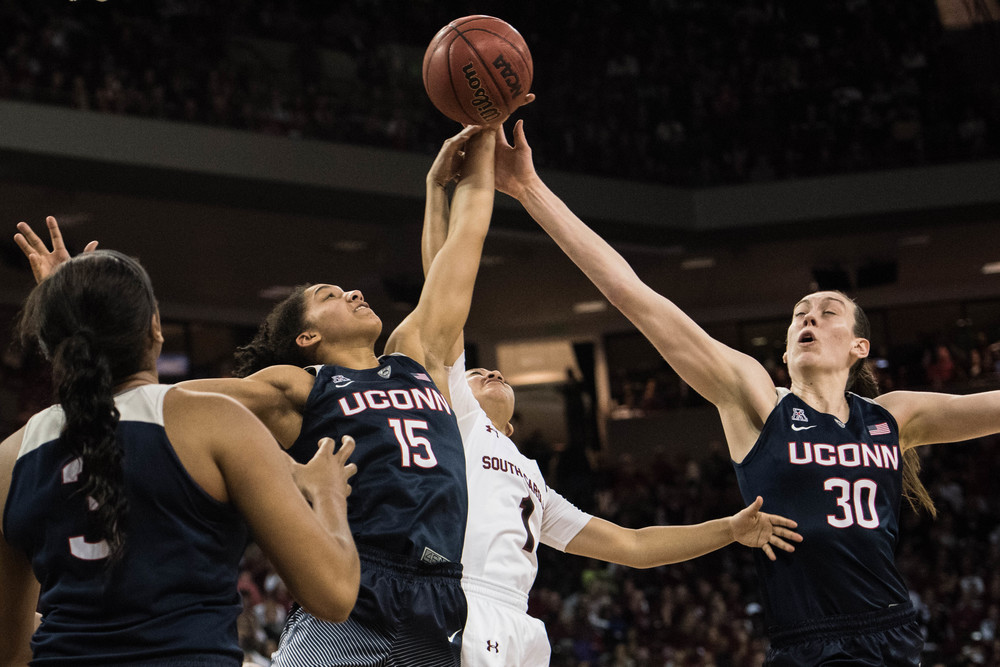 Connecticut forward Breanna Stewart (30) and teammate Gabby Williams (15) battle South Carolina guard Bianca Cuevas (1) during the second half of an NCAA college basketball game Monday, Feb. 8, 2016, in Columbia, S.C. (AP Photo/Sean Rayford)