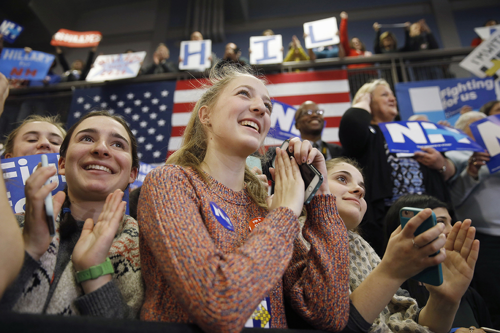 Female  Attendees listen as Democratic presidential candidate  Hillary   Clinton  speak during a campaign stop, Monday, Feb. 8, 2016, at Manchester Community College in Manchester, N.H. (AP Photo/Matt Rourke)