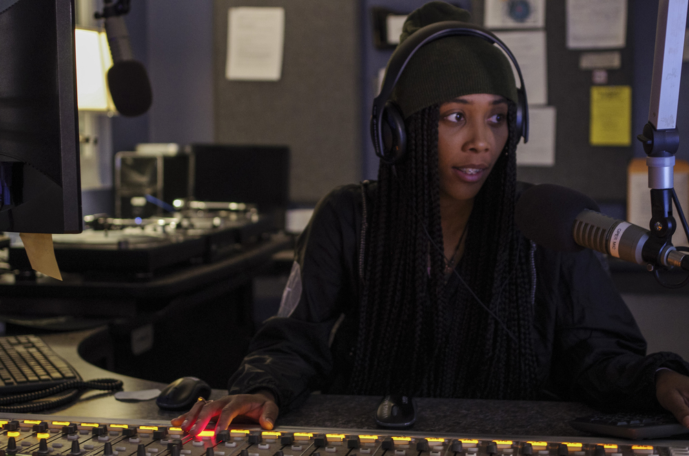 Student DJ Alyssa Hughes takes over the airwaves on 91.7 WHUS, UConn's radio station. WHUS, like The Daily Campus and other Tier III organzations, is largely funded through student fees. (William Chan/Daily Campus)