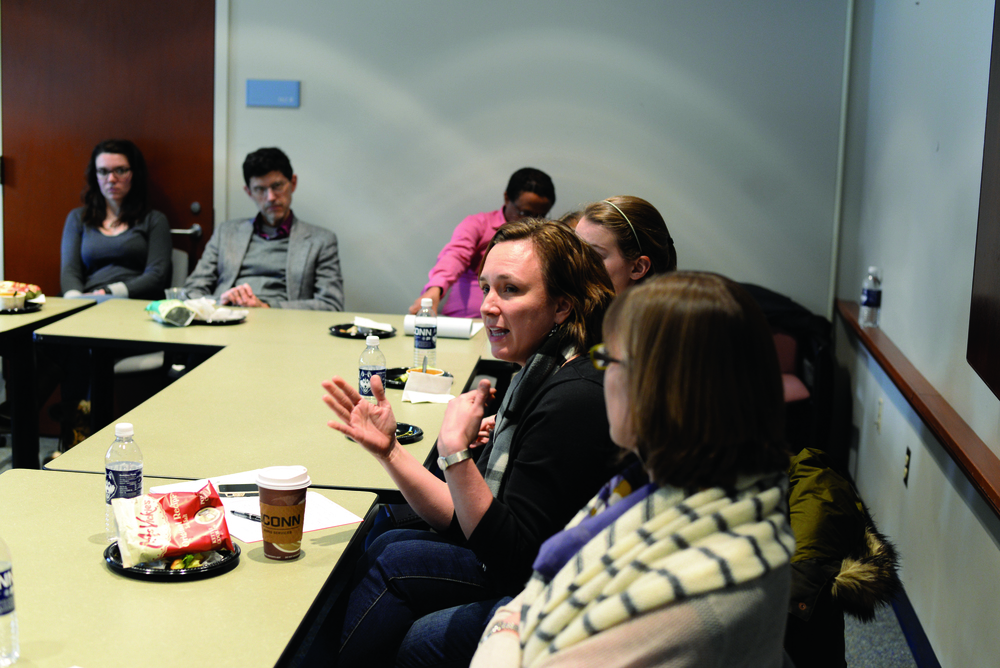 Human rights professor Molly Land adds to the conversation at postdoctoral fellow Andrew Janko's presentation on unregulated migration and the refugee crisis. (Amar Batra/Daily Campus)