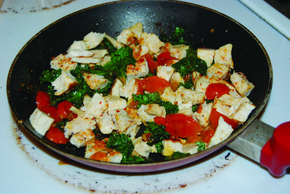 Cook the chicken, kale, and tomatoes like so. (Margaux Lea/The Daily Campus)