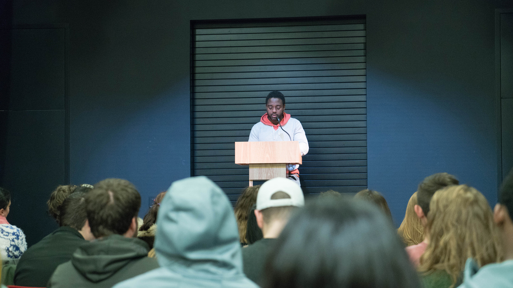 Reginald Swayne Betts, memoirist and teacher, gives a poetry reading at the Storrs Center Co-op Bookstore (Erming Gao/The Daily Campus)