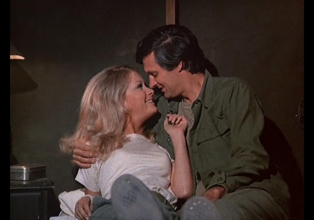 "Actors Joan Van Ark (left) and Alan Alda are seen during an episode of M*A*S*H, ""Radar's Report,"" which aired in 1973. (Classic Film/Creative Commons)"