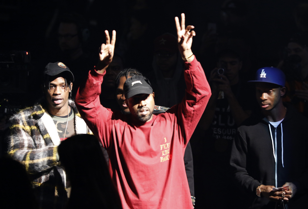 "Kanye West gestures to the audience at the unveiling of the Yeezy collection and album release for his latest album, ""The Life of Pablo,"" Thursday, Feb. 11, 2016 at Madison Square Garden in New York. (AP Photo/Bruce Barton)"
