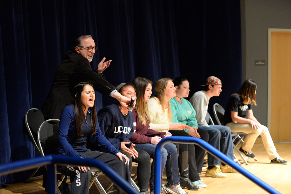 Comedian and hypnotist Jim Spinnato is seen on stage with hypnotized students in the Student Union Theater in Storrs, Connecticut on Thursday, Feb. 11, 2016. (Amar Batra/The Daily Campus)