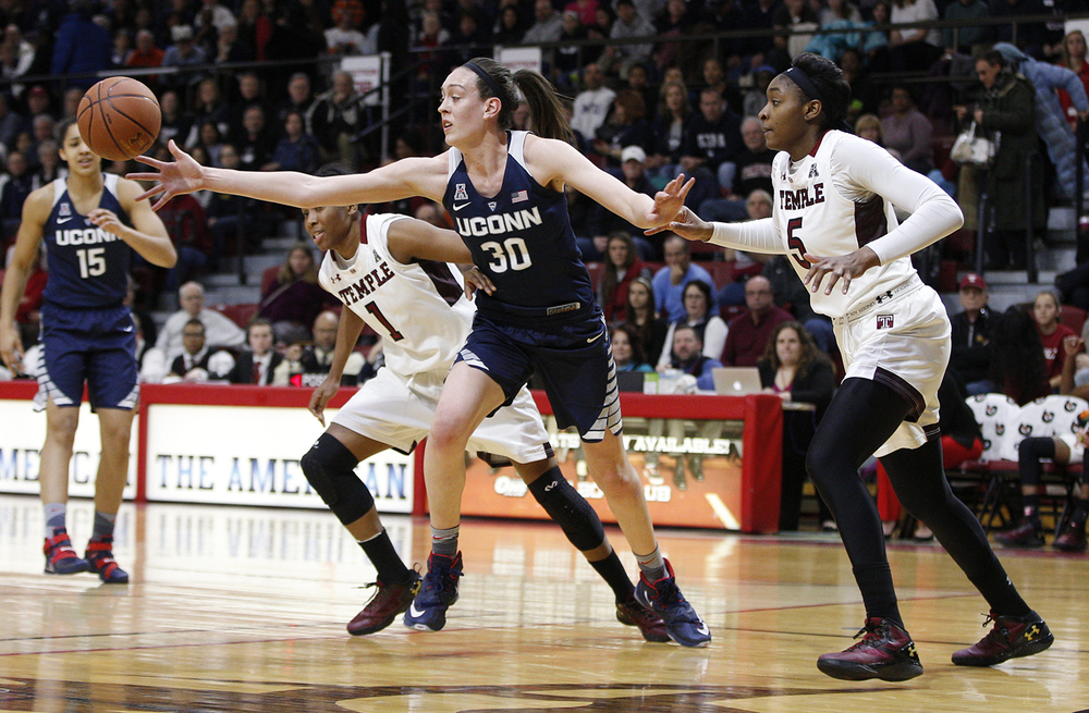 Connecticut's Breanna Stewart (30) reaches for the loose ball as Temple's Ugo Nwaigwe (5) and Erica Covile (1) is guarding her during the first half of an NCAA basketball game, Sunday, Feb. 14, 2016, in Philadelphia. (AP Photo/Chris Szagola)
