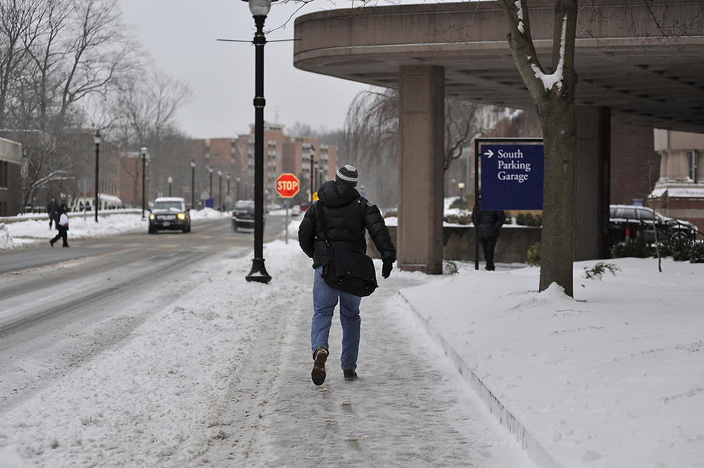 A student is seen walking at the UConn campus in Storrs, Connecticut during a snow day on Monday, Feb. 8, 2016. (Jason Jiang/The Daily Campus)