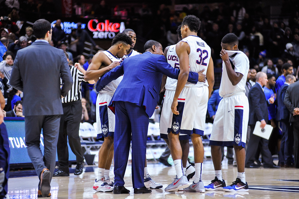 UConn men's basketball head coach Kevin Ollie huddles with members of the team during a timeout in the Huskies' game against Tulsa at Gampel Pavilion in Storrs, Connecticut on Saturday, Feb. 13, 2016. (Jason Jiang/The Daily Campus)