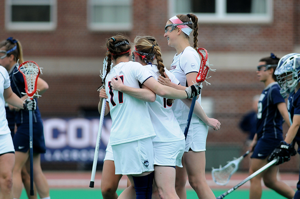 Members of the UConn women's lacrosse celebrate a goal scored in a game last season. The Huskies open their season on Wednesday against Quinnipiac. (File photo)