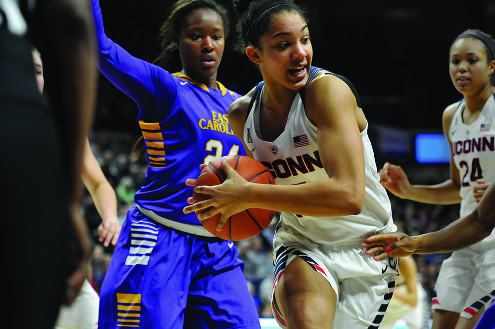 Forward Gabby Williams grabs the ball away from an East Carolina defender during UConn's 92-46 victory on Feb. 6, 2016. (Bailey Wright/The Daily Campus)
