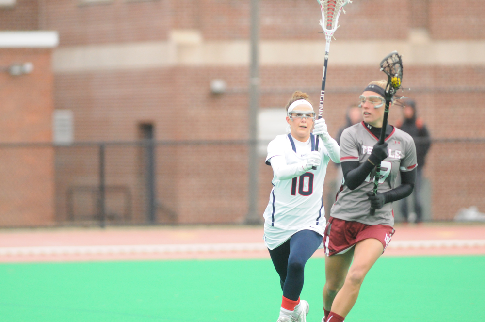 In this file photo from April 8, 2015, game against Temple University, sophomore Grace Nolan takes on an opponent. Nolan picked up where she left off last season as Rookie of the Year with seven goals against the Quinnipiac Bobcats.