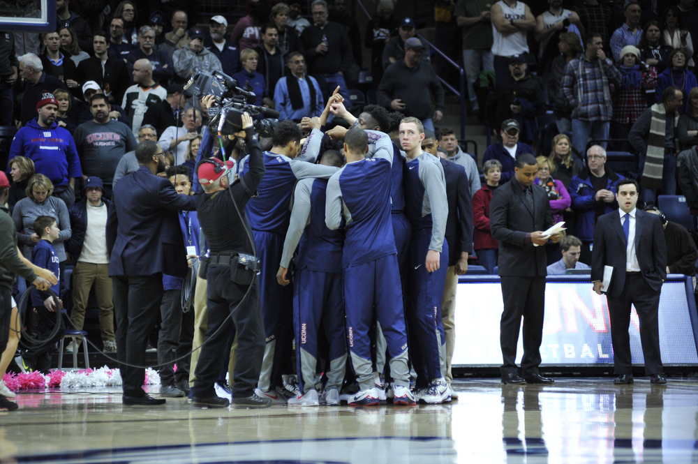 The UConn men's basketball team huddles up before playing University of Tulsa on Feb. 13, 2016. (Jason Jiang/Daily Campus)