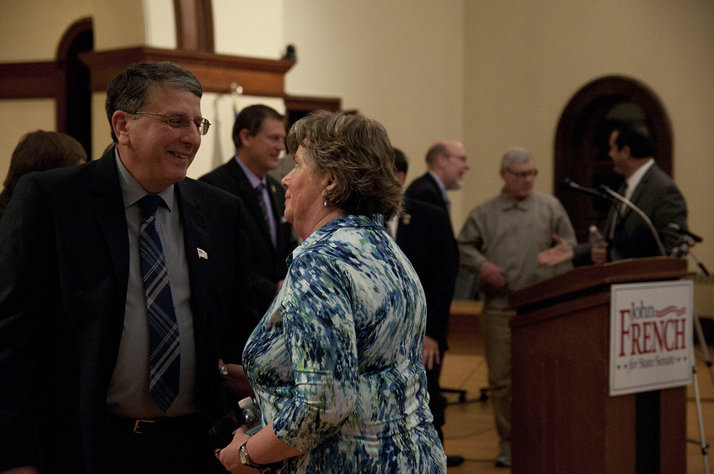 John French, a Republican member of the Windham Board of Education, announced his plan to run for a State Senate seat in the 29th district. He is seen here speaking with his wife. (Bailey Wright/The Daily Campus)