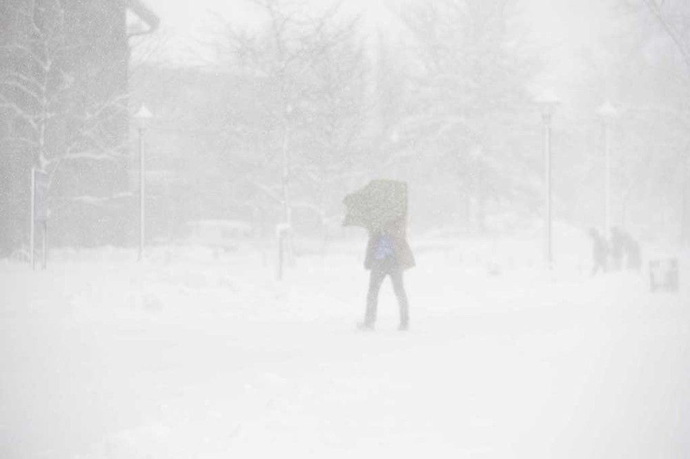 A student attempts to brave the brutal Storrs blizzard on Feb. 2, 2016. Is the snow truly the worst part of winters at UConn? (Jason Jiang/The Daily Campus)