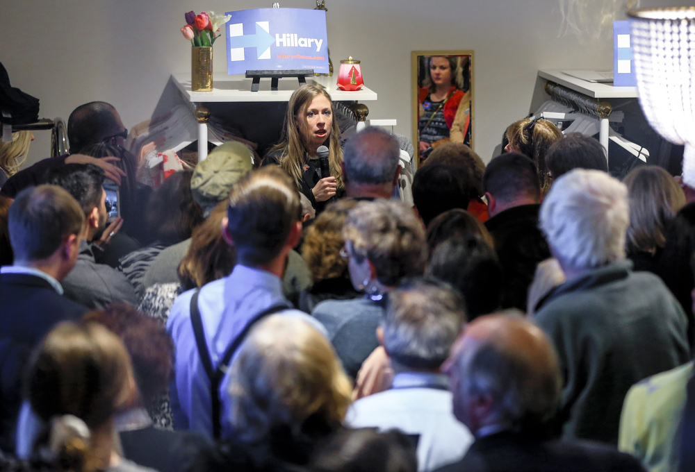 Chelsea Clinton campaigns on behalf of her mother, Democratic presidential candidate Hillary Clinton, surrounded by press and attendees during a campaign event at the Four Sisters Boutique in Omaha, Neb., Wednesday, Feb. 17, 2016. (AP Photo/Nati Harnik)