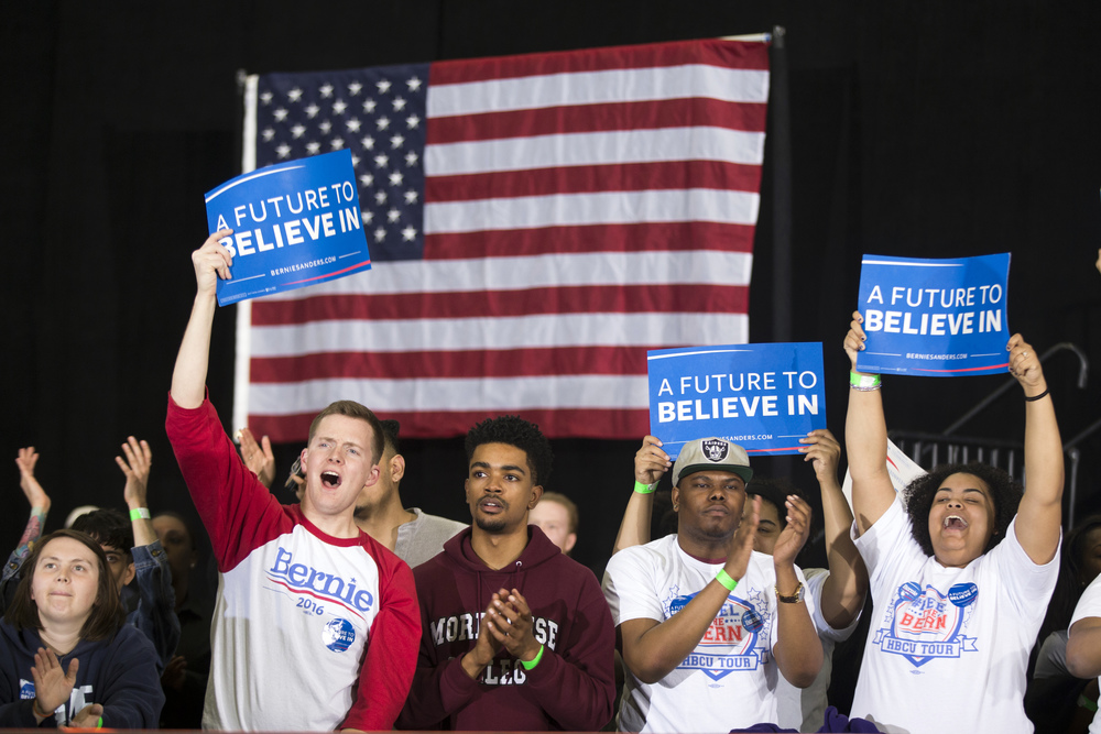 People cheer as Democratic presidential candidate Sen. Bernie Sanders, I-Vt., speaks during a rally at Morehouse College, on Tuesday, Feb. 16, 2016, in Atlanta. (AP Photo/Evan Vucci)