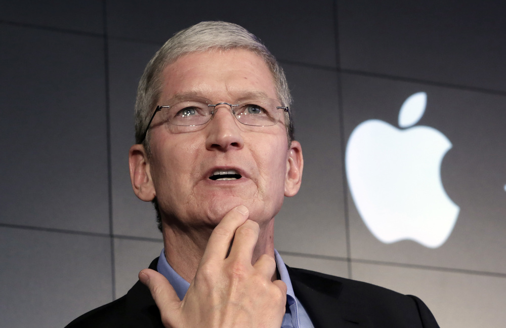 In this April 30, 2015, file photo, Apple CEO Tim Cook responds to a question during a news conference at IBM Watson headquarters, in New York. Cook said his company will resist a federal magistrate's order to hack its own users in connection with the investigation of the San Bernardino, Calif., shootings. In a statement posted early Wednesday, Feb. 17, 2016, on the company's website, Cook argued that such a move would undermine encryption by creating a backdoor that could potentially be used on other future devices. (AP Photo/Richard Drew, File)