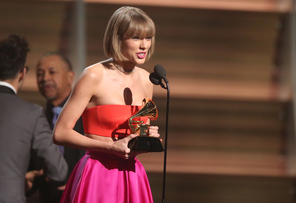 "Taylor Swift accepts the award for album of the year for ""1989"" at the 58th annual Grammy Awards on Monday, Feb. 15, 2016, in Los Angeles. (Matt Sayles/Invision/AP)"