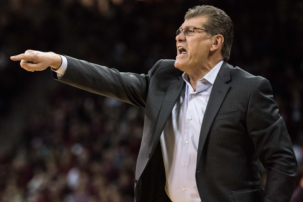 Connecticut head coach Geno Auriemma communicates with his team during the first half of an NCAA college basketball game against South Carolina, Monday, Feb. 8, 2016, in Columbia, S.C. (AP Photo/Sean Rayford)