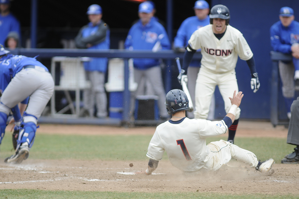 Centerfielder Jack Sundberg scores a run during UConn's 3-1 loss against Memphis last season. (File Photo/The Daily Campus)
