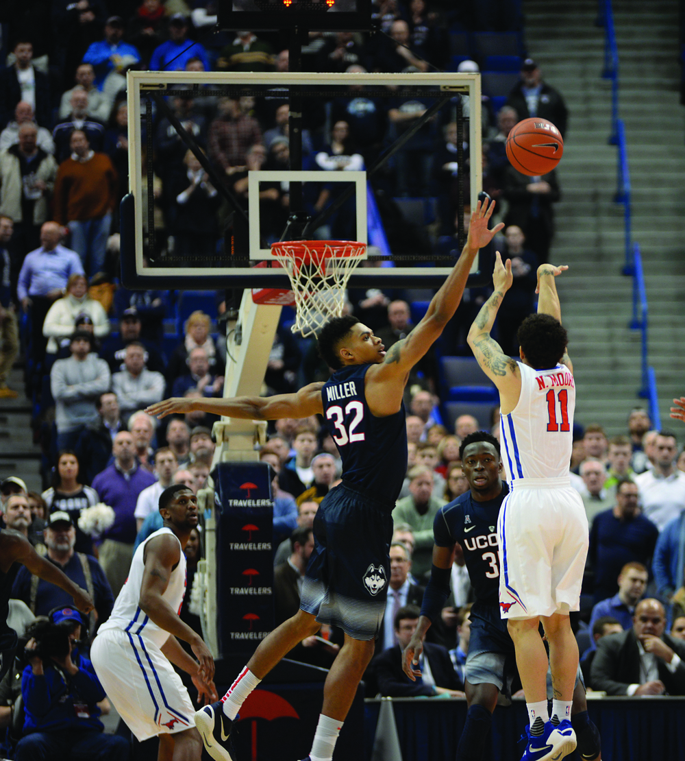 UConn forward Shonn Miller contests a shot from SMU's Nic Moore during a 68-62 victory at the XL Center on Feb. 18, 2016. SMU holds a 4-2 all-time edge on the Huskies. Photo by Amar Batra, senior staff photographer/The Daily Campus