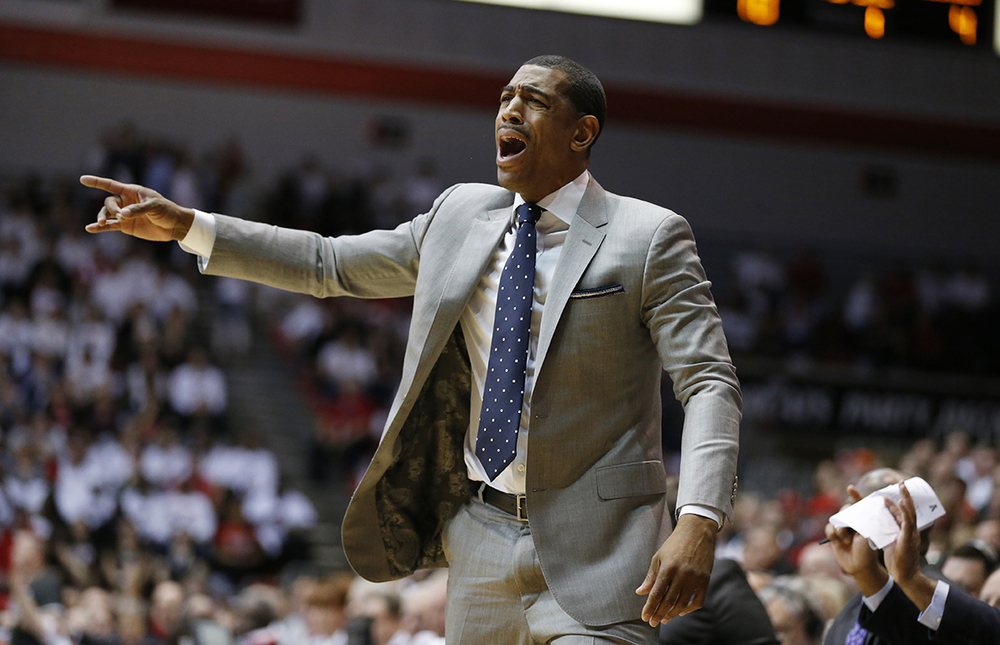 Connecticut head coach Kevin Ollie shouts instructions during the first half of an NCAA college basketball game against Cincinnati, Saturday, Feb. 20, 2016, in Cincinnati. (AP Photo/Gary Landers)