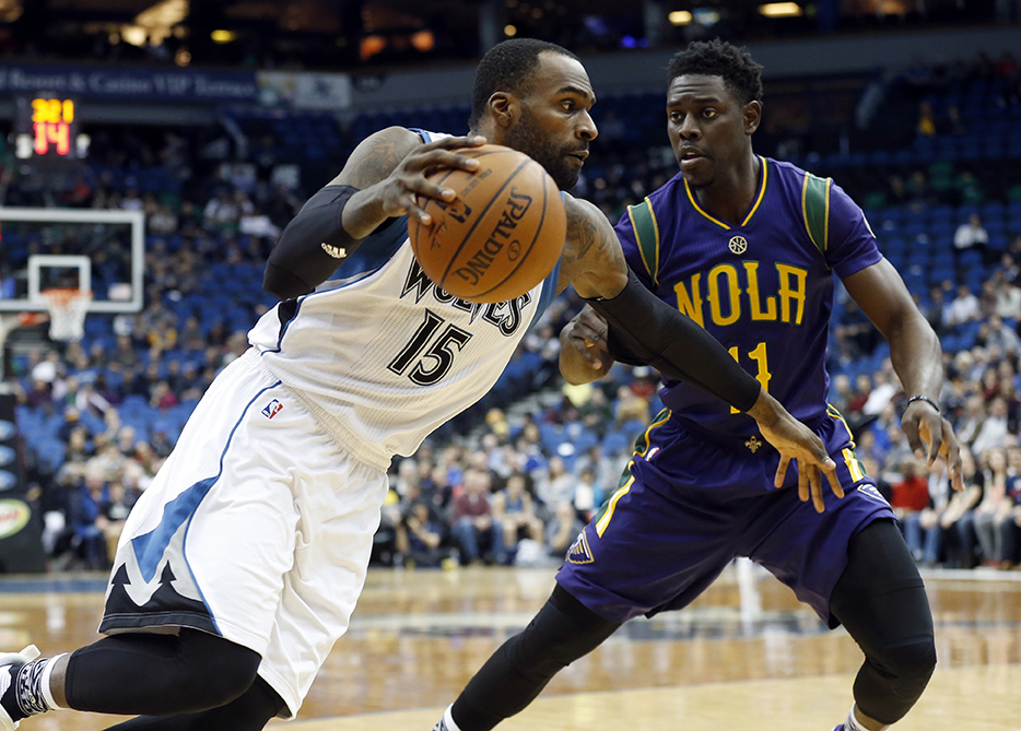 Minnesota Timberwolves' Shabazz Muhammad, left, drives around New Orleans Pelicans' Jrue Holiday in the first quarter of an NBA basketball game, Monday, Feb. 8, 2016, in Minneapolis. (AP Photo/Jim Mone)