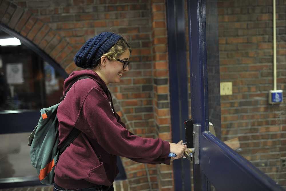 A student is seen swiping into Buckley Residence Hall with her UConn One card. (Jason Jiang/The Daily Campus)