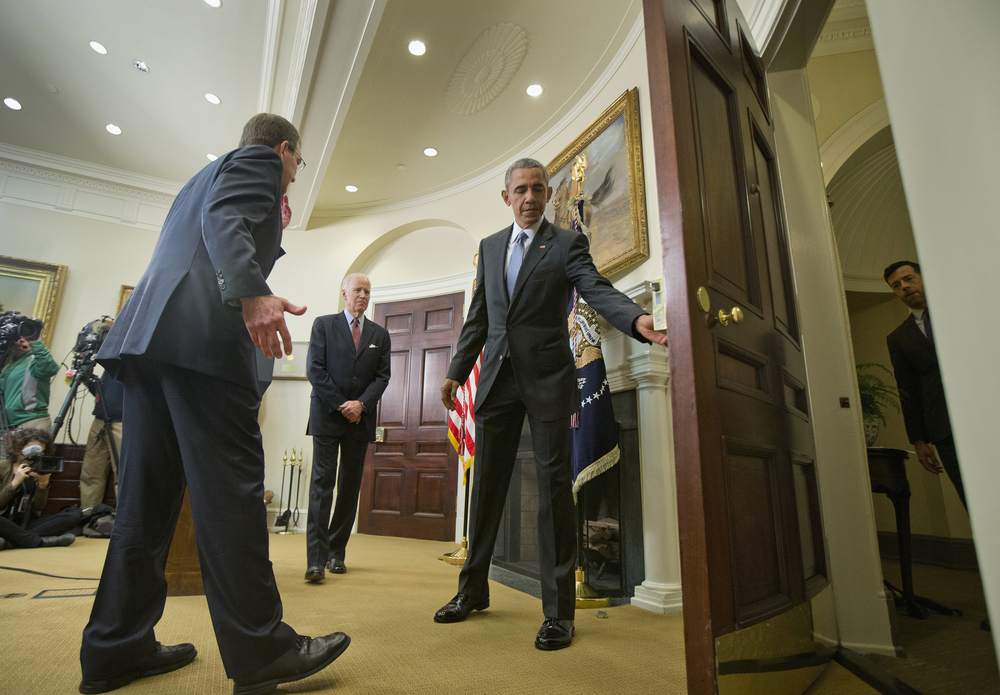 President Barack Obama opens the door for Vice President Joe Biden, center, and Defense Secretary Ash Carter, after speaking in the Roosevelt Room of the White House in Washington, Tuesday, Feb. 23, 2016. Obama announced Pentagon's long-awaited plan to shut down the detention center at Guantanamo Bay, Cuba, and transfer the remaining detainees to a facility in the U.S. The plan is Obama's last-ditch effort to make good on campaign vow to close Guantanamo. (AP Photo/Pablo Martinez Monsivais)