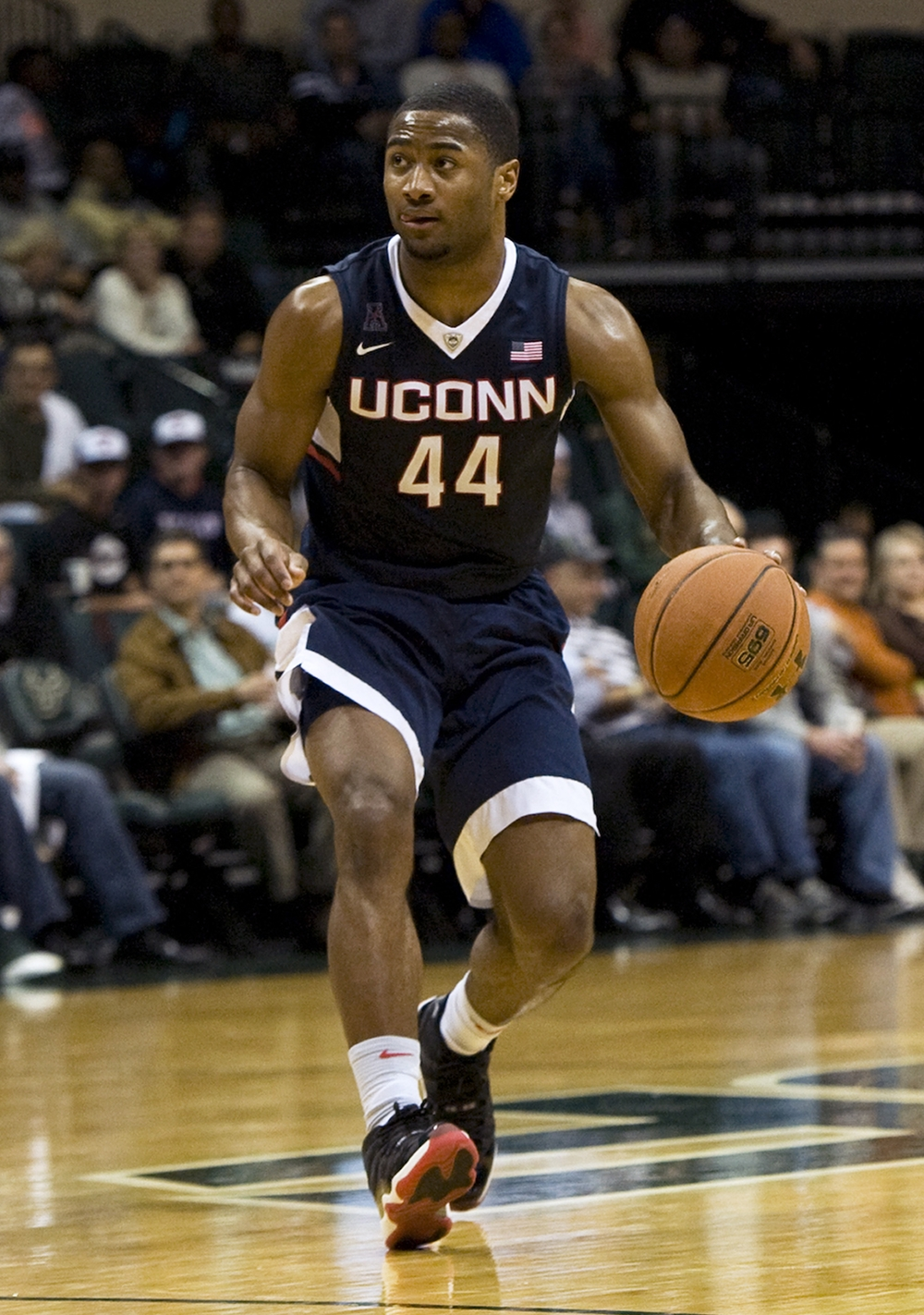 Connecticut's Rodney Purvis moves the ball downcourt against South Florida during the second half of an NCAA college basketball game Thursday, Feb. 25, 2016 in Tampa, Fla. Purvis scored 18 points to lead Connecticut in a 81-51 win over South Florida. (AP Photo/Steve Nesius)