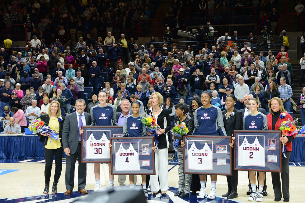 It was Senior Day at Gampel Pavilion on Saturday Feb. 27, 2016. Breanna Stewart, #30, Moriah Jefferson, #4, Morgan Tuck, #3, and Briana Pulido, #2, were honored pregame. Assistant coach Chris Dailey, center, was inducted into the Huskies of Honor along with Stewart and Jefferson. (Amar Batra/The Daily Campus)