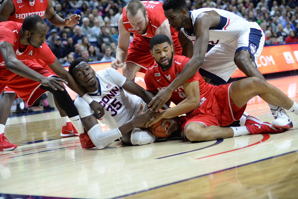 Center Amida Brimah, #35, fights for a loose ball during UConn's 75-68 loss to Houston at Gampel Pavilion on Sunday Feb. 28, 2016. Brimah finished with 10 points and seven rebounds. (Ashley Maher/The Daily Campus)