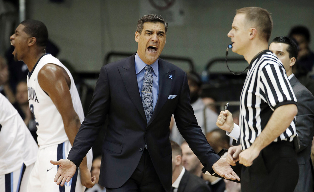 Villanova head coach Jay Wright, center, reacts to a call during the first half of an NCAA college basketball game against Butler, Saturday, Feb. 20, 2016, in Villanova, Pa. (AP Photo/Matt Slocum)