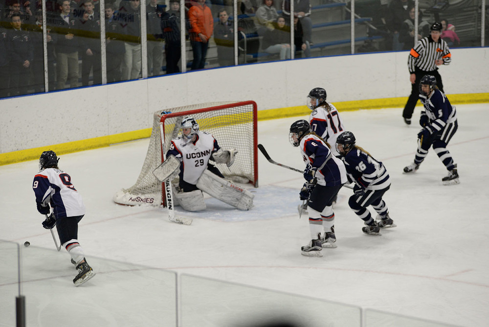 Goalie Elaine Chuli sees the puck to safety during UConn's 4-3