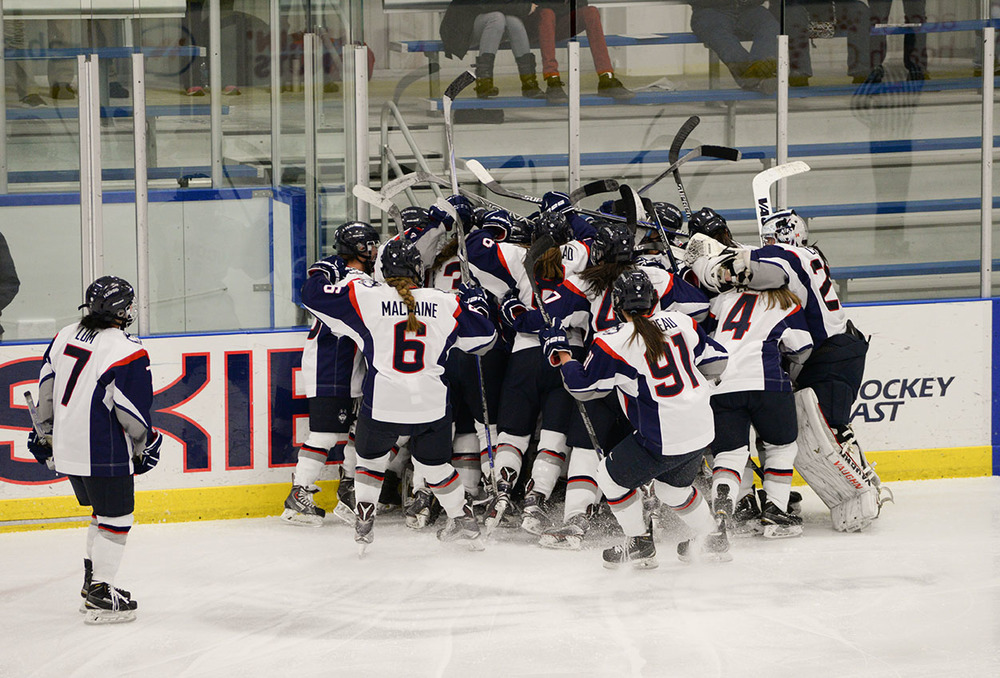 The UConn women's hockey team celebrates Leah Buress' triple overtime goal at the Freitas Ice Forum on Saturday Feb. 27, 2016. The Huskies are headed to the Hockey East semifinals. (Amar Batra/The Daily Campus)