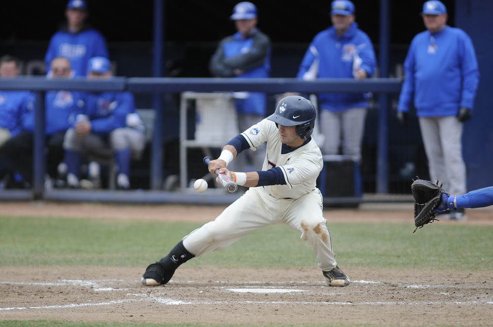 Centerfielder Jack Sundberg attempts to lay down a bunt during a game against Memphis last season. Sundberg is hitting .400 through five games for the Huskies. (File Photo)