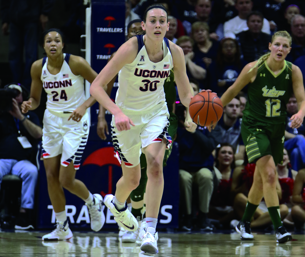 UConn forward Breanna Stewart dribbles the ball up the court in a game on Monday, Feb. 29 against the University of South Florida at Gampel Pavilion. Stewart finished the game with 27 points. (Tyler Benton/The Daily Campus)