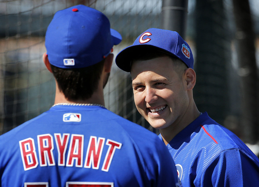 Chicago Cubs' Kris Bryant and Anthony Rizzo talk during spring training baseball practice, Wednesday, Feb. 24, 2016, in Mesa, Ariz. (AP Photo/Matt York)