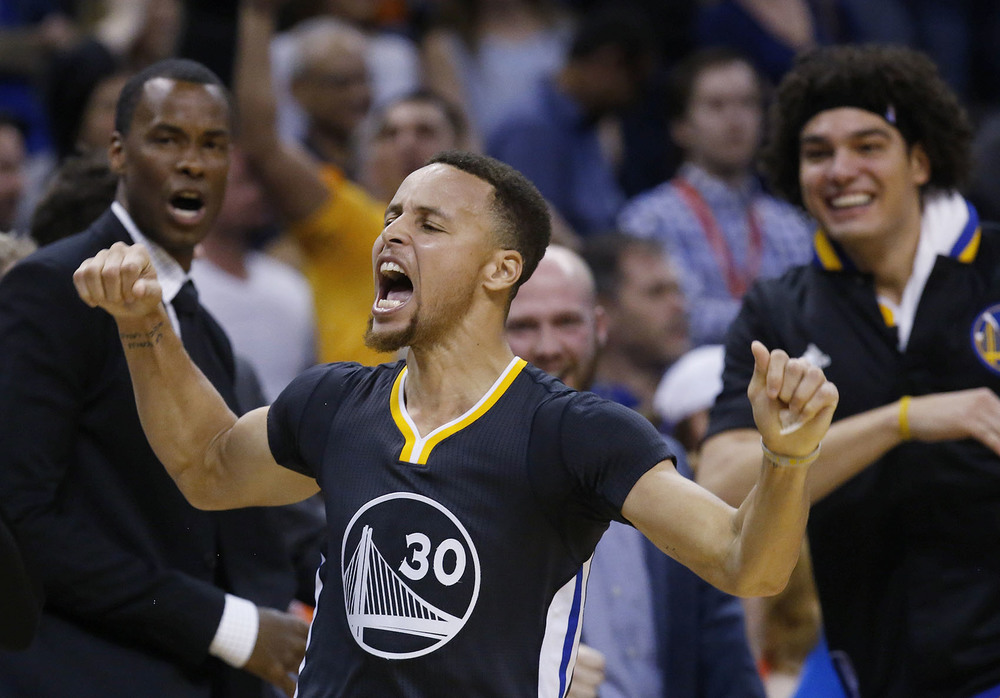 Golden State Warriors guard Stephen Curry (30) celebrates after hitting the game-winning shot in overtime of an NBA basketball game against the Oklahoma City Thunder in Oklahoma City, Saturday, Feb. 27, 2016. Golden State won 121-118. (AP Photo/Sue Ogrocki)