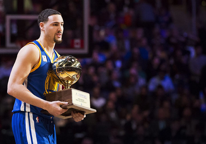 Golden State Warriors guard Klay Thompson (11) receives his trophy after winning the three point competition during the NBA all-star skills competition in Toronto on Saturday, Feb. 13, 2016. (Mark Blinch/The Canadian Press via AP)