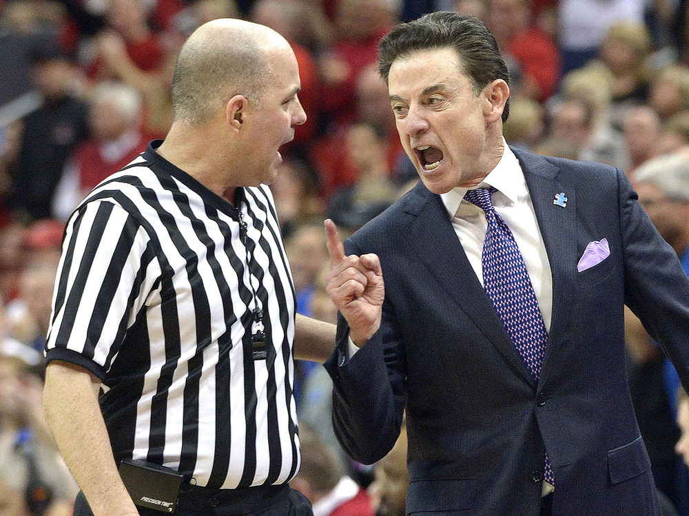 Louisville head coach Rick Pitino, right, argues with referee Brian Dorsey during the second half of an NCAA college basketball game against Duke, Saturday, Feb. 20, 2016 in Louisville Ky. Louisville won 71-64. (AP Photo/Timothy D. Easley)