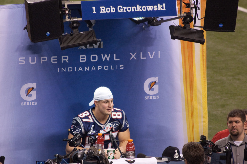 Rob Gronkowksi answering questions during Media Day prior to Super Bowl XLVI. Gronkowski and his entourage recently returned from a hedonistic booze cruise, which sparked questions about the way the media covers his exploits. (Angie Six/Flickr)