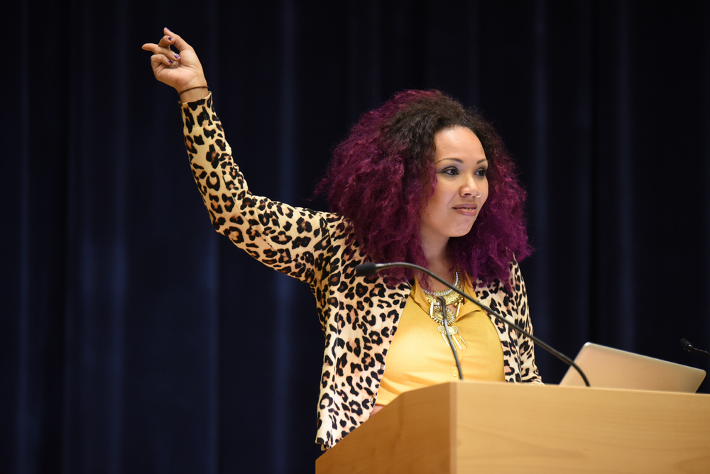 Jamilah Lemieux, the Senior Editor at EBONY, the magazine of record for African-Americans since 1945, gives a speech on feminism to the start the Women's History Month in the Student Union Theater on Tuesday night. (Zhelun Lang/The Daily Campus)