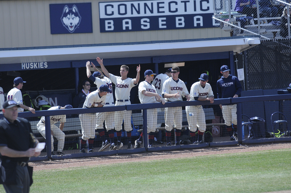 The UConn baseball team celebrates during a game last season at J.O. Christian Field. The Huskies have won four games in a row after dropping their opening two games in walk off fashion. (Amar Batra/The Daily Campus)